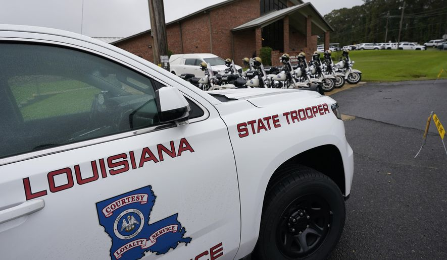 FILE - In this Sept. 25, 2020 file photo, a heavy Louisiana State Police presence is seen at the New Chapel Hill Baptist Church during funeral services for Master Trooper Chris Hollingsworth in West Monroe, La.    An Associated Press review of thousands of records has revealed multiple cases when Louisiana State troopers and some of their supervisors exchanged emails with casual, demeaning uses of the n-word. All of it comes against the backdrop of a federal civil rights investigation over the in-custody death of a Black motorist that has roiled the state's premier law enforcement agency and led to an abrupt change in its leadership. (AP Photo/Rogelio V. Solis, File)