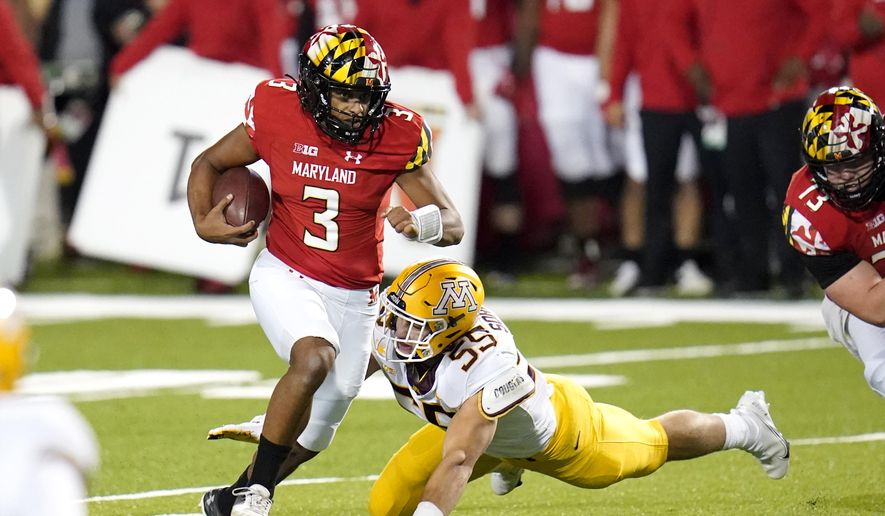 Maryland quarterback Taulia Tagovailoa (3) scrambles for yardage as Minnesota linebacker Mariano Sori-Marin attempts a tackle during the first half of an NCAA college football game, Friday, Oct. 30, 2020, in College Park, Md. (AP Photo/Julio Cortez)  **FILE**