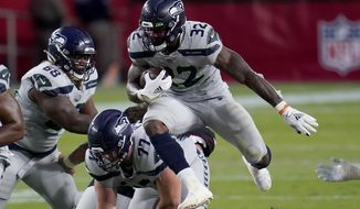 Seattle Seahawks running back Chris Carson (32) runs against the Arizona Cardinals during the first half of an NFL football game, Sunday, Oct. 25, 2020, in Glendale, Ariz. (AP Photo/Ross D. Franklin)