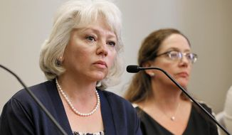 FILE - In this March 24, 2015 file photo Debra Milke speaks at a news conference in Phoenix. Milke spent 22 years on death row in her son's killing before her conviction was thrown out in 2013. A judge dismissed Milke's wrongful-conviction lawsuit on Friday, Oct. 30, 2020, after concluding Milke's destruction of records in the civil case prevents the true facts from emerging. (AP Photo/Matt York, File)