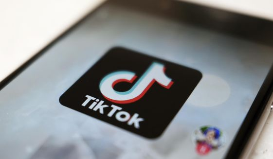 This Monday, Sept. 28, 2020, file photo, shows as  logo of a smartphone app TikTok on a user post on a smartphone screen in Tokyo. (AP Photo/Kiichiro Sato, File)  **FILE**