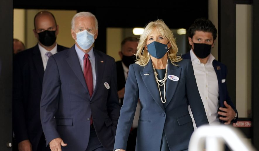 In this Wednesday, Oct. 28, 2020, file photo, Democratic presidential candidate former Vice President Joe Biden and his wife Jill Biden leave after voting at the Carvel State Office Building in Wilmington, Del. (AP Photo/Andrew Harnik, File)