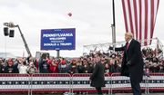 President Donald Trump throws a hat to supporters before he speaks at a campaign rally at Reading Regional Airport, Saturday, Oct. 31, 2020, in Reading, Pa. (AP Photo/Alex Brandon)