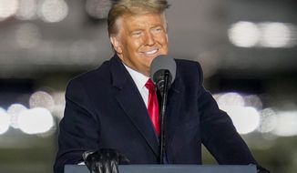 President Donald Trump smiles as he addresses the crowd during a campaign stop, Saturday, Oct. 31, 2020, at the Butler County Regional Airport in Butler, Pa. (AP Photo/Keith Srakocic)