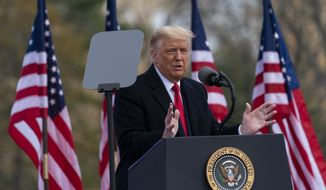 President Donald Trump speaks at a campaign rally at Keith House, Washington's Headquarters, Saturday, Oct. 31, 2020, in Newtown, Pa. (AP Photo/Alex Brandon)