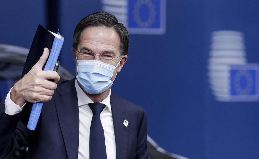 Dutch Prime Minister Mark Rutte arrives for an EU summit in Brussels, Friday, Oct. 16, 2020. European Union leaders meet for the second day of an EU summit, amid the worsening coronavirus pandemic, to discuss topics on foreign policy issues. (Olivier Hoslet, Pool via AP)