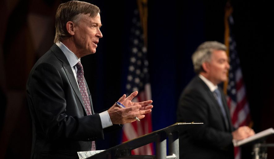 FILE - In this Oct. 13, 2020 file photo Democratic challenger John Hickenlooper, front, talks during a debate with Republican U.S. Senator Cory Gardner during a debate between the candidates in Fort Collins, Colo. Democrats seeking to pick up senate seats in Montana and Colorado are painting their opponents as a threat to the undeveloped public lands for which the two Rocky Mountain states are known. (Bethany Baker File)/The Coloradoan via AP, File)