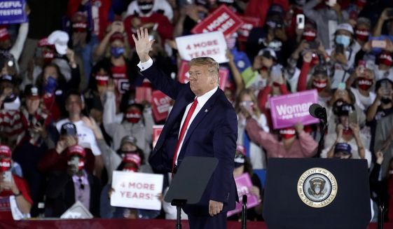 President Donald Trump waves as he leaves after speaking at a campaign rally at Middle Georgia Regional Airport, Friday, Oct. 16, 2020, in Macon, Ga. (AP Photo/John Bazemore) **FILE**