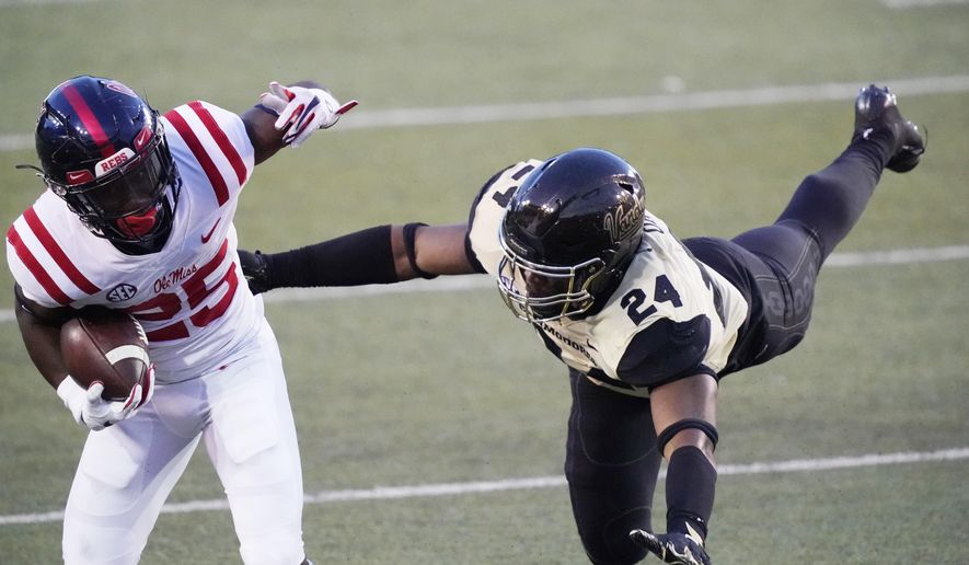 Mississippi running back Henry Parrish Jr. (25) gets past Vanderbilt linebacker Alston Orji (24) in the second half of an NCAA college football game Saturday, Oct. 31, 2020, in Nashville, Tenn. Mississippi won 54-21. (AP Photo/Mark Humphrey)