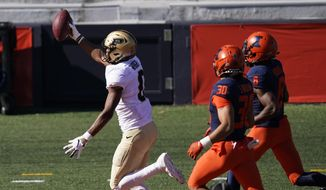 Purdue wide receiver Milton Wright, left, celebrate his touchdown reception as Illinois defensive back Sydney Brown (30) and Nate Hobbs watch during the first half of an NCAA college football game Saturday, Oct. 31, 2020, in Champaign, Ill. (AP Photo/Charles Rex Arbogast)