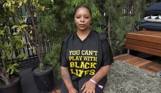 In this Nov. 4, 2018, file photo, Patrisse Cullors poses for a photo on day three of Summit LA18 in Los Angeles. (Photo by Amy Harris/Invision/AP, File)