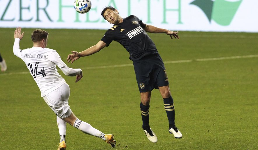 FILE - Philadelphia Union's Alejandro Bedoya, right, and Chicago Fire's Djordje Mihailovic, left, go after the ball during the second half of an MLS soccer match Wednesday, Oct. 28, 2020, in Chester, Pa. The best team in MLS is the one with the least awareness in Philadelphia. But the Union have emerged after 12 long years not only as a team on the brink of clinching the best record in the league with a win Sunday, Nov. 1,  but as a true contender to win the championship. (Charles Fox/The Philadelphia Inquirer via AP, File)