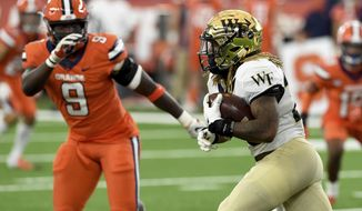 Wake Forest Demon Deacons running back Christian Beal-Smith (26) during the first half of an NCAA college football game against Syracuse on Saturday, Oct. 31, 2020, in Syracuse, N.Y. (Dennis Nett/The Post-Standard via AP)