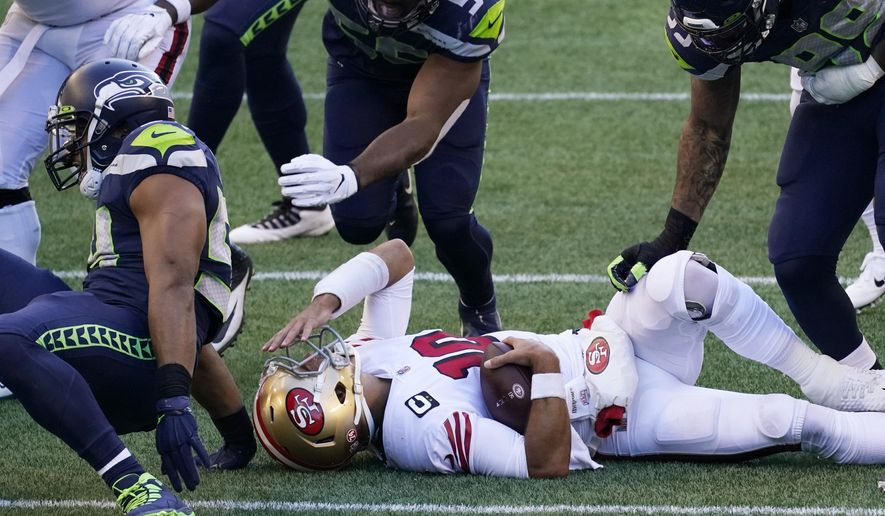 San Francisco 49ers quarterback Jimmy Garoppolo reacts after he was sacked by Seattle Seahawks middle linebacker Bobby Wagner during the first half of an NFL football game, Sunday, Nov. 1, 2020, in Seattle. (AP Photo/Elaine Thompson)