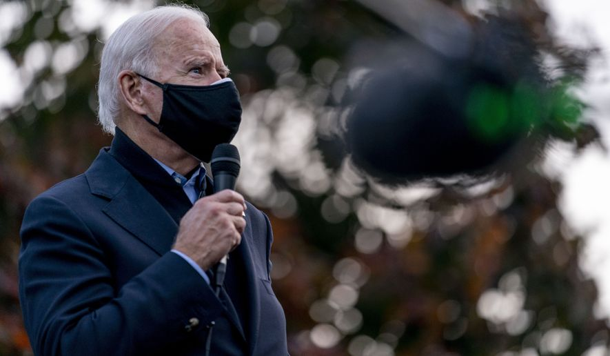 Democratic presidential candidate former Vice President Joe Biden speaks to people at a canvas kick off event with Rep. Brendan Boyle, D-Pa., in Philadelphia, Sunday, Nov. 1, 2020. (AP Photo/Andrew Harnik)