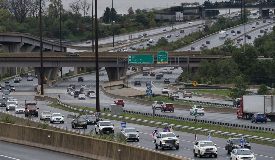 Supporters of President Donald Trump with decorated vehicles, caravan on the I-495 Capital Beltway, Sunday, Nov. 1, 2020, in Fort Washington, Md. (AP Photo/Alex Brandon)