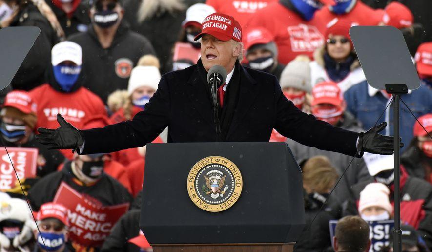 President Donald Trump speaks during a campaign rally at Michigan Sports Stars Park, Sunday, Nov. 1, 2020, in Washington, Mich. (AP Photo/Jose Juarez) ** FILE **
