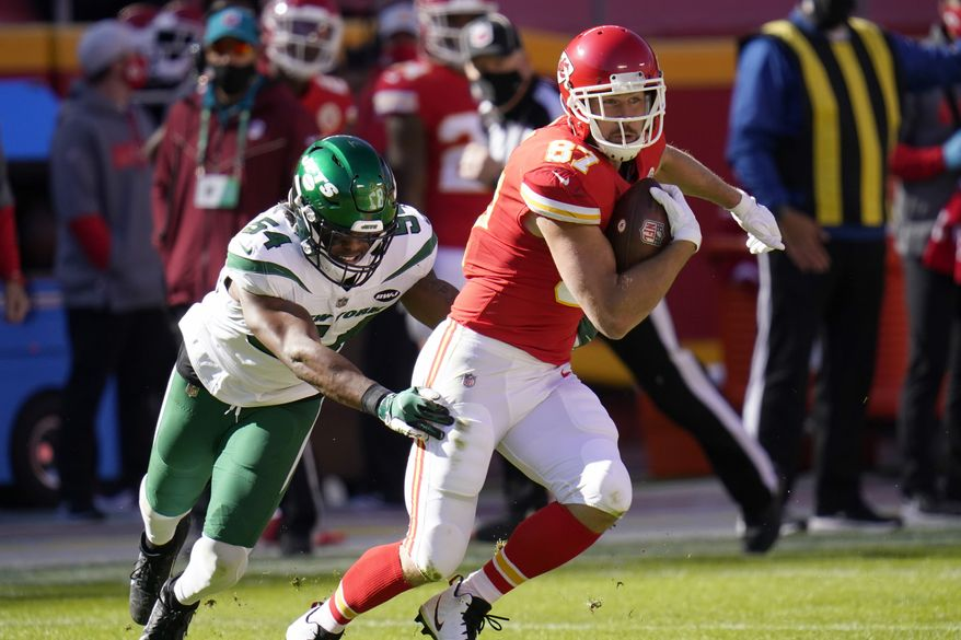 Kansas City Chiefs tight end Travis Kelce (87) catches a pass as New York Jets linebacker Avery Williamson (54) defends during the first half of an NFL football game Sunday, Nov. 1, 2020, in Kansas City, Mo. (AP Photo/Jeff Roberson)