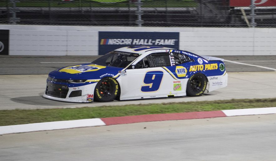 Chase Elliott (9) drives during final laps during a NASCAR Cup Series auto race at the Martinsville Speedway in Martinsville, Va., Sunday, Nov.1, 2020. (AP Photo/Lee Luther Jr.)
