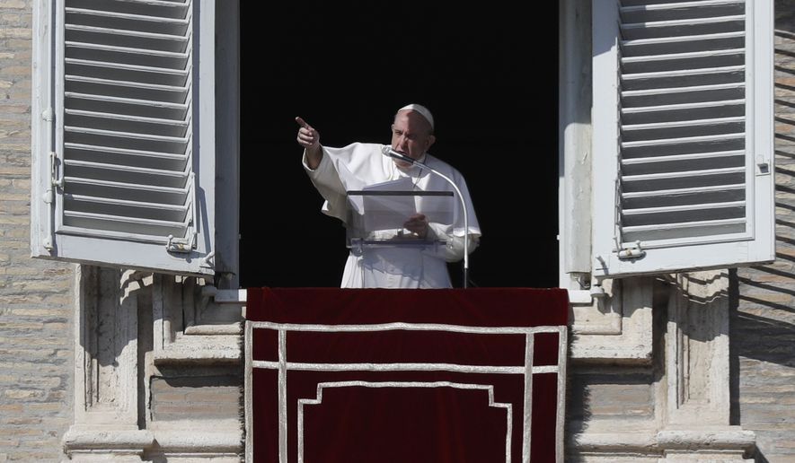 Pope Francis delivers the Angelus noon prayer in St. Peter's Square at the Vatican, Sunday, Nov. 1, 2020. (AP Photo/Gregorio Borgia)