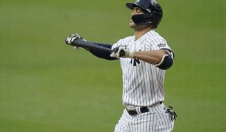 New York Yankees' Giancarlo Stanton reacts after striking out against the Tampa Bay Rays during the fifth inning in Game 4 of a baseball American League Division Series Thursday, Oct. 8, 2020, in San Diego. (AP Photo/Gregory Bull)