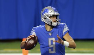 Detroit Lions quarterback Matthew Stafford throws during the first half of an NFL football game against the Indianapolis Colts, Sunday, Nov. 1, 2020, in Detroit. (AP Photo/Tony Ding)