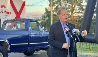 Democratic U.S. Sen. Doug Jones, of Alabama, speaks at a drive-in car rally in Troy, Ala., on Oct. 22, 2020. Jones faces Republican Tommy Tuberville in Tuesday's election. (AP Photo/Kim Chandler)