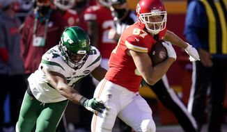New York Jets linebacker Avery Williamson (54) attempts to stop Kansas City Chiefs tight end Travis Kelce (87) from gaining yardage after a catch in the first half of an NFL football game on Sunday, Nov. 1, 2020, in Kansas City, Mo. (AP Photo/Jeff Roberson)