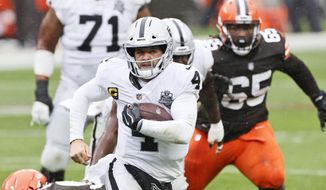 Las Vegas Raiders quarterback Derek Carr (4) rushes during the first half of an NFL football game against the Cleveland Browns, Sunday, Nov. 1, 2020, in Cleveland. (AP Photo/Ron Schwane)