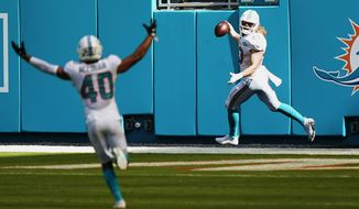 Miami Dolphins outside linebacker Andrew Van Ginkel (43) smiles after scoring a touchdown during the first half of an NFL football game against the Los Angeles Rams, Sunday, Nov. 1, 2020, in Miami Gardens, Fla. Van Ginkel picked up the ball after Los Angeles Rams quarterback Jared Goff (16) was sacked and fumbled the ball. (AP Photo/Wilfredo Lee)