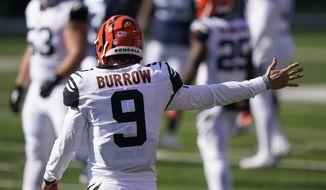 Cincinnati Bengals quarterback Joe Burrow (9) motions a first down during the first half of an NFL football game against the Tennessee Titans, Sunday, Nov. 1, 2020, in Cincinnati. (AP Photo/Bryan Woolston)