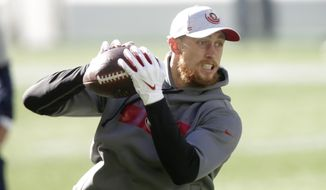 San Francisco 49ers tight end George Kittle makes a catch as he warms up before an NFL football game against the Seattle Seahawks, Sunday, Nov. 1, 2020, in Seattle. (AP Photo/Scott Eklund)
