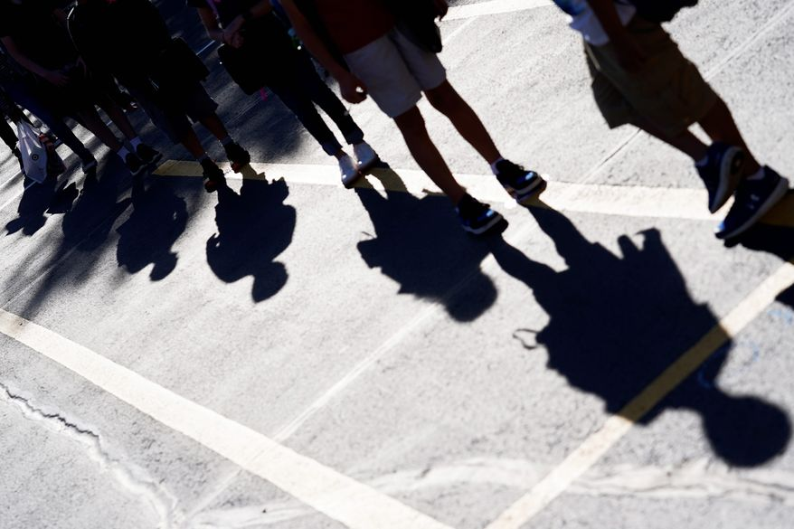 Students line up for their classroom outside of Oak Terrace Elementary School in Highwood, Ill., Thursday, Sept. 3, 2020. (AP Photo/Nam Y. Huh)