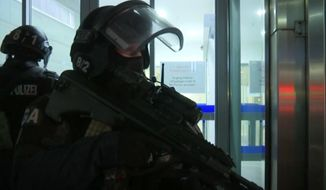 In this image made from video, police at the scene after gunshots were heard, in Vienna, Monday, Nov. 2, 2020. Austrian police say several people have been injured and officers are out in force following gunfire in the capital Vienna. Initial reports that a synagogue was the target of an attack couldnt immediately be confirmed. Austrian news agency APA quoted the countrys Interior Ministry saying one attacker has been killed and another could be on the run. (AP Photo)