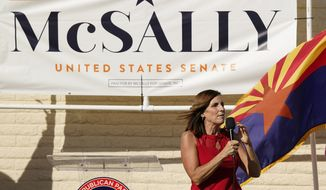 Arizona Republican Sen. Martha McSally campaigns at Republican Party Headquarters Monday, Nov. 2, 2020, in Phoenix. McSally is running against Democratic candidate Mark Kelly in the election set for tomorrow. (AP Photo/Ross D. Franklin)