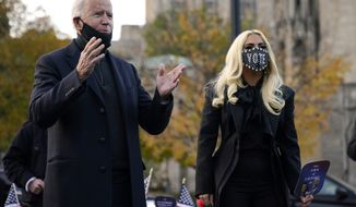 Democratic presidential candidate former Vice President Joe Biden stands with Lady Gaga, right, Monday, Nov. 2, 2020, in Pittsburgh, Pa. (AP Photo/Andrew Harnik)