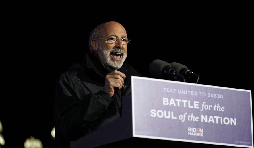 Pennsylvania Gov. Tom Wolf speaks during a drive-in rally for Democratic presidential candidate former Vice President Joe Biden at Heinz Field, Monday, Nov. 2, 2020, in Pittsburgh. (AP Photo/Andrew Harnik)