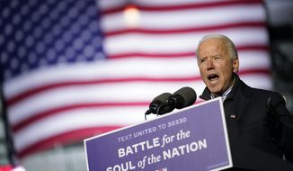 Democratic presidential candidate former Vice President Joe Biden speaks at a drive-in rally at Heinz Field, Monday, Nov. 2, 2020, in Pittsburgh. (AP Photo/Andrew Harnik)