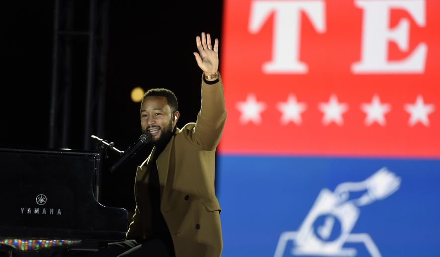 Performer John Legend plays the piano during a drive-in get out the vote rally featuring Democratic vice presidential candidate Sen. Kamala Harris, D-Calif., Monday, Nov. 2, 2020, in Philadelphia. (AP Photo/Michael Perez)