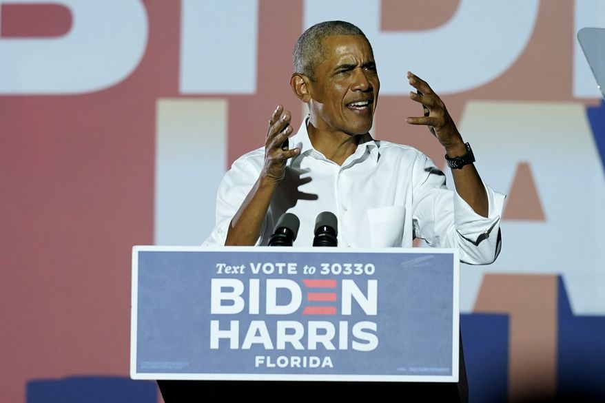 Former President Barack Obama speaks at a rally as he campaigns for Democratic presidential candidate former Vice President Joe Biden, Monday, Nov. 2, 2020, in Miami. (AP Photo/Lynne Sladky)