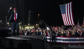President Donald Trump walks off stage after speaking during a campaign rally at Miami-Opa-locka Executive Airport, Monday, Nov. 2, 2020, in Opa-locka, Fla. (AP Photo/Evan Vucci)