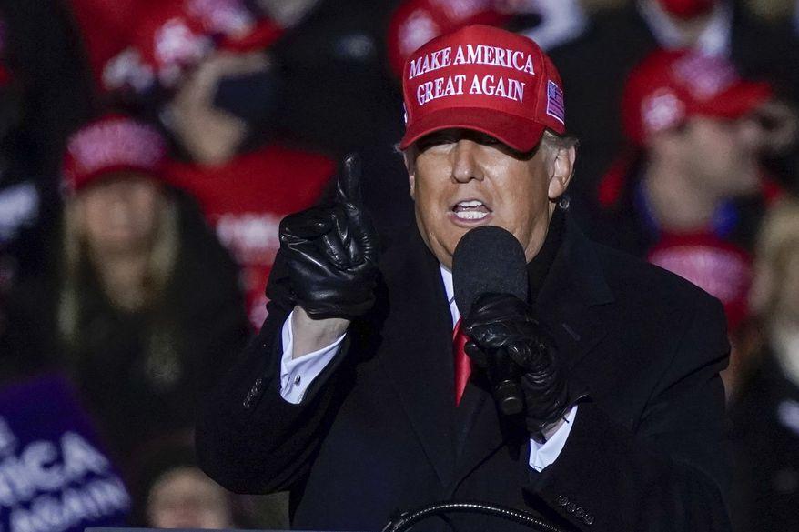 President Donald Trump speaks at a campaign event at the Kenosha Regional Airport Monday, Nov. 2, 2020, in Kenosha, Wis. (AP Photo/Morry Gash)