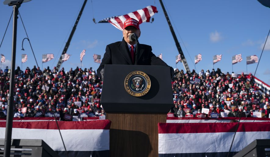 President Donald Trump speaks during a campaign rally at Wilkes-Barre Scranton International Airport, Monday, Nov. 2, 2020, in Avoca, Pa. (AP Photo/Evan Vucci)