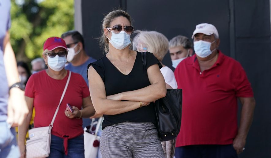 Of the 25 U.S. counties reporting the highest number of new COVID-19 cases during the current surge, 21 had mask mandates in place before August. (Associated Press/File)