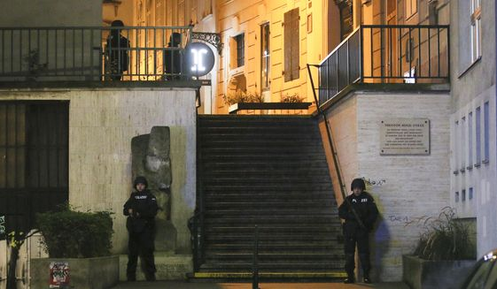 Police officers stay in position at stairs named 'Theodor Herzl Stiege' near a synagogue after gunshots were heard, in Vienna, Monday, Nov. 2, 2020. Austrian police say several people have been injured and officers are out in force following gunfire in the capital Vienna. Initial reports that a synagogue was the target of an attack couldn't immediately be confirmed. Austrian news agency APA quoted the country's Interior Ministry saying one attacker has been killed and another could be on the run.(Photo/Ronald Zak)
