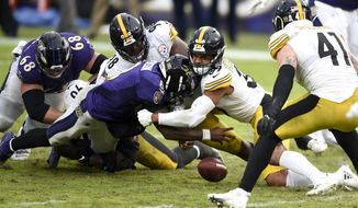 Baltimore Ravens quarterback Lamar Jackson, front left, fumbles the ball while being hit by Pittsburgh Steelers free safety Minkah Fitzpatrick (39) and inside linebacker Vince Williams (98) during the second half of an NFL football game, Sunday, Nov. 1, 2020, in Baltimore. The Steelers won 28-24. Steelers linebacker Robert Spillane (41) recovered the fumble. (AP Photo/Gail Burton)