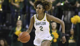 FILE - In this Feb. 29, 2020, file photo, Baylor's DiDi Richards brings the ball upcourt against Kansas State in the second half of an NCAA college basketball game in Waco, Texas. Baylor senior guard Richards has no structural damage to her spine and is recovering from a vicious collision in practice with a teammate that initially left her without any feeling in her lower legs, though her status for the season remained uncertain Monday, Nov. 2, 2020. (AP Photo/Rod Aydelotte, File)