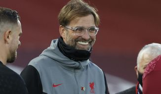 Liverpool's manager Jurgen Klopp smiles ahead of the English Premier League soccer match between Liverpool and West Ham United at Anfield stadium in Liverpool, England, Saturday, Oct. 31, 2020. (Clive Brunskill/Pool via AP)