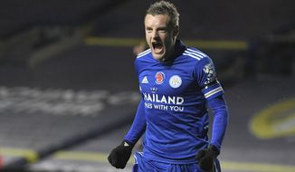 Leicester's Jamie Vardy celebrates after scoring his sides third goal of the game during the English Premier League soccer match between Leeds United and Leicester City at Elland Road in Leeds, England, Monday, Nov. 2, 2020. (Michael Regan/Pool via AP)