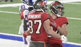 Tampa Bay Buccaneers' Rob Gronkowski (87), left, celebrates his touchdown with Cameron Brate during the second half of an NFL football game against the New York Giants, Monday, Nov. 2, 2020, in East Rutherford, N.J. (AP Photo/Bill Kostroun)